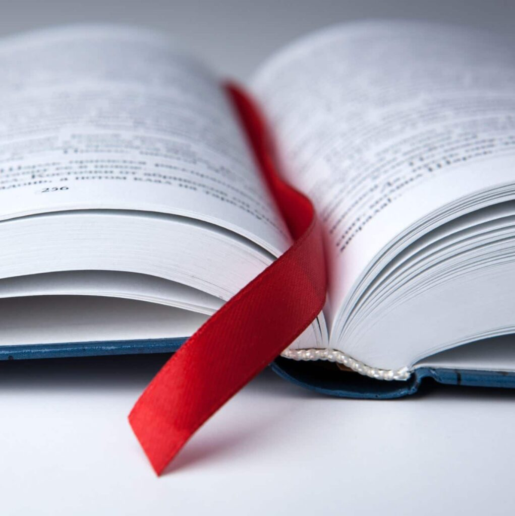 A close-up shot of a bookmark between a book's pages.