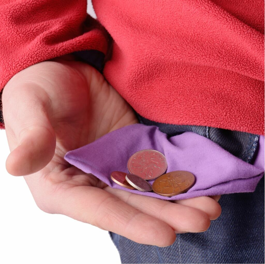 A man holding pocket change in his palm.