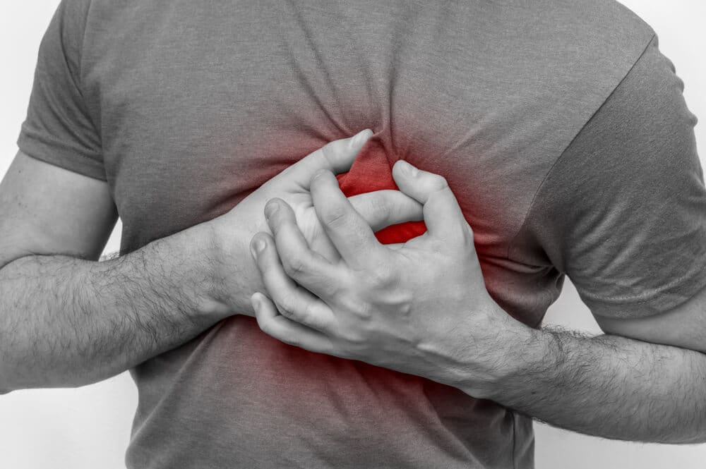 Man having chest pain, heart attack - black and white photo