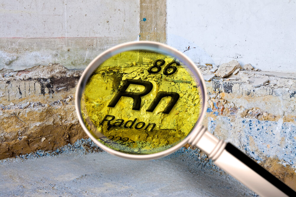 Preparatory stage for the construction of a ventilated crawl space in an old brick building - Searching gas radon concept image seen through a magnifying glass.