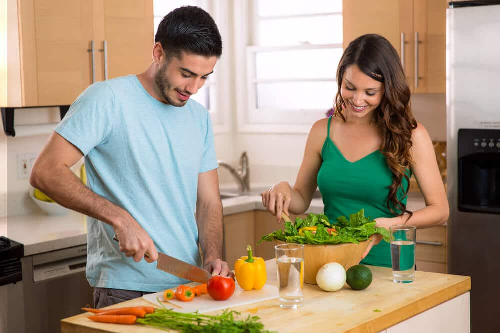 Home chefs prepare a happy healthy nutrition based low calorie meal