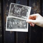Hand holds two vintage photographs