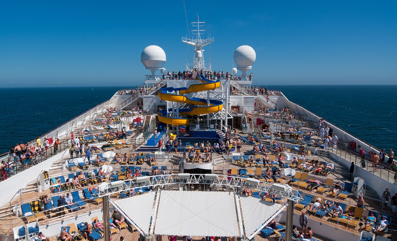 Passengers have fun on the sunny deck of a cruise ship
