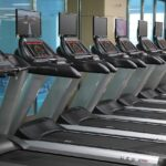 A line of treadmills at a fitness studio