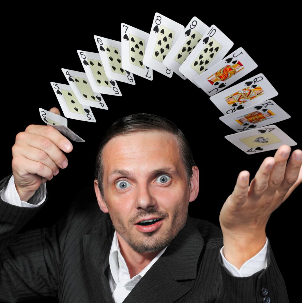 A magician flipping through a deck of cards.