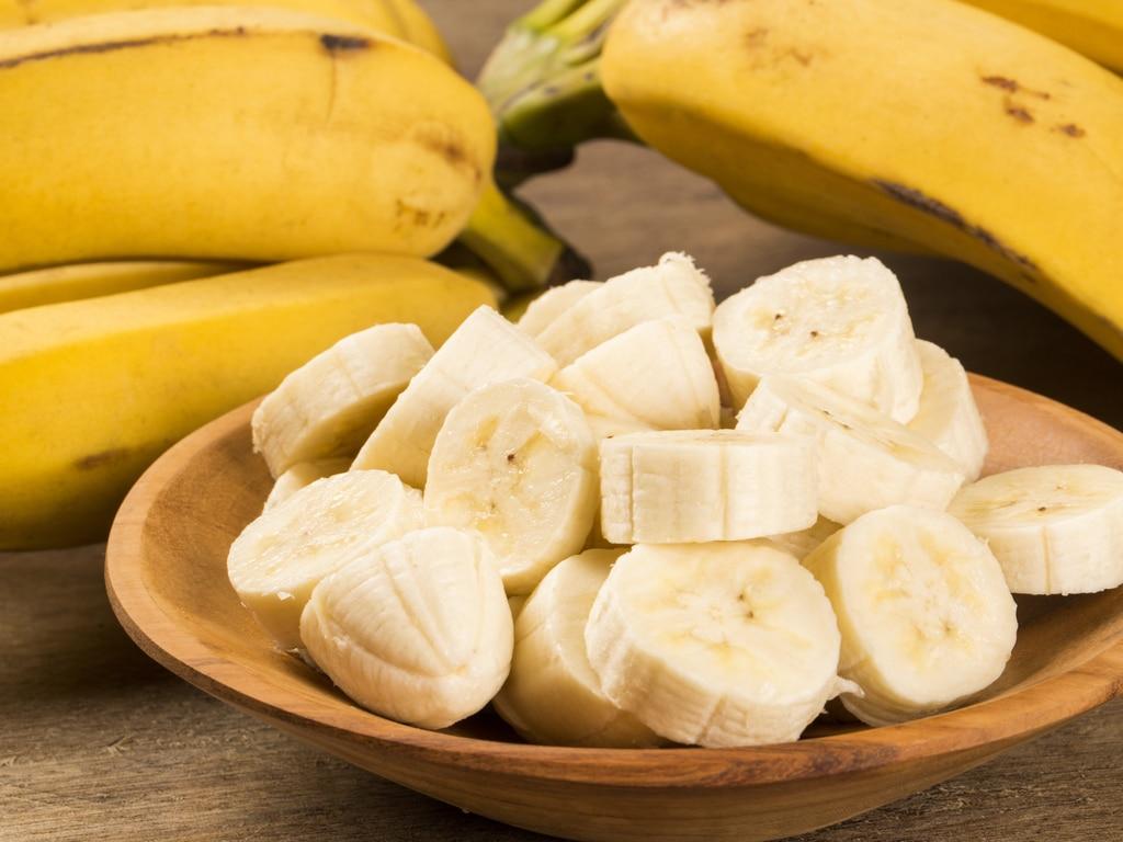 A bowl of cut up bananas.