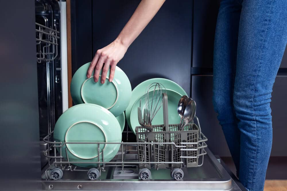 doing dishes in a modern kitchen with dishwasher