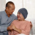 asian senior couple having encouragement when wife having cancer and being treat with chemotherapy