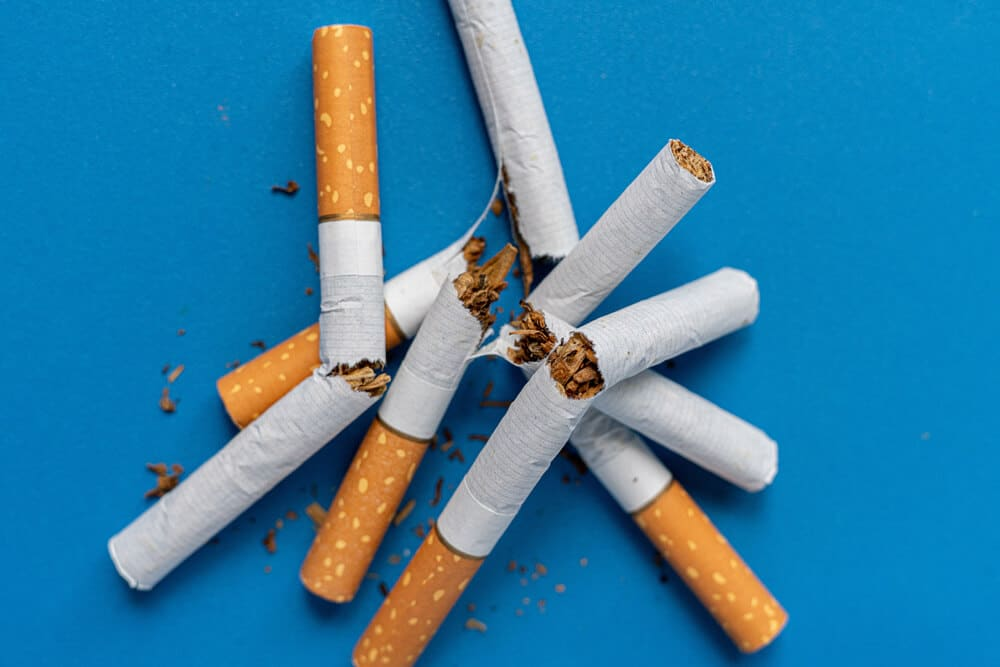 a no tobacco day, a broken cigarette on color background isolated on color surface, stop smoking