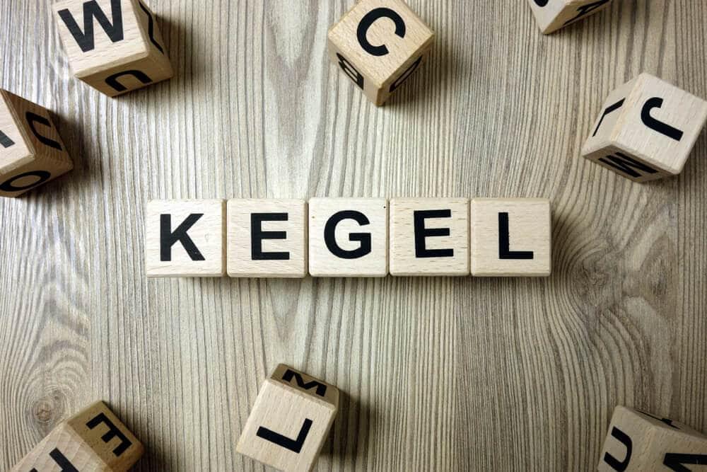 Word kegel from wooden blocks on desk
