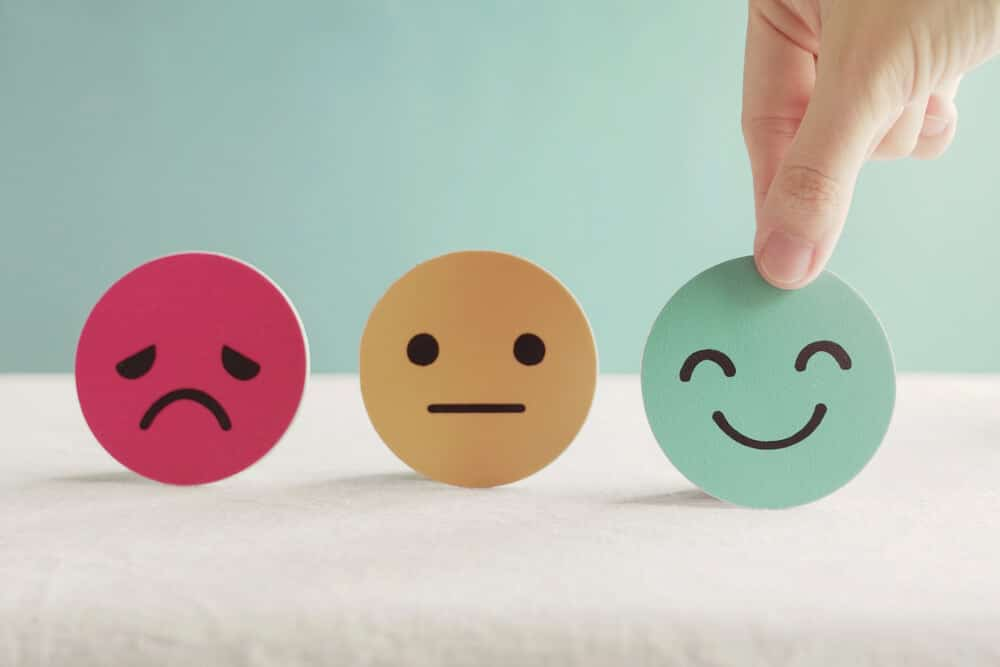 Hand choosing happy smile face paper cut, good feedback rating and positive customer review, experience, satisfaction survey ,mental health assessment, world mental health day concept