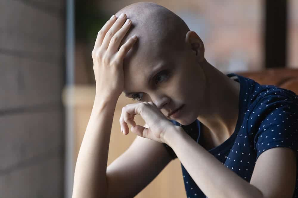 Upset sad young Caucasian woman with hairless bald head suffer from cancer feel depressed crying at home alone, unhappy sick female patient with oncology distressed with bad results, health problems